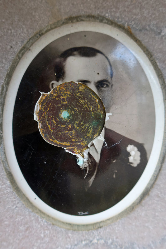 bullet mark in enamel portrait