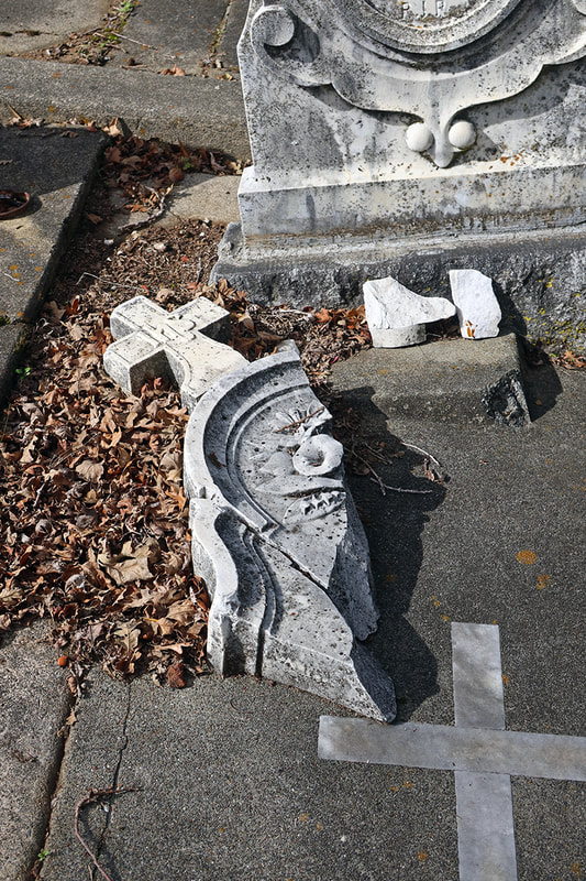 broken gross from gravestone