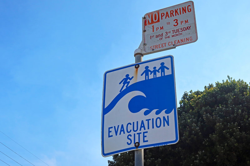 Evacuation site sign