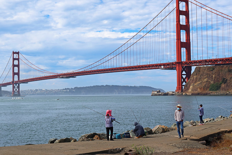 people fishing near Golden Gate Bridge