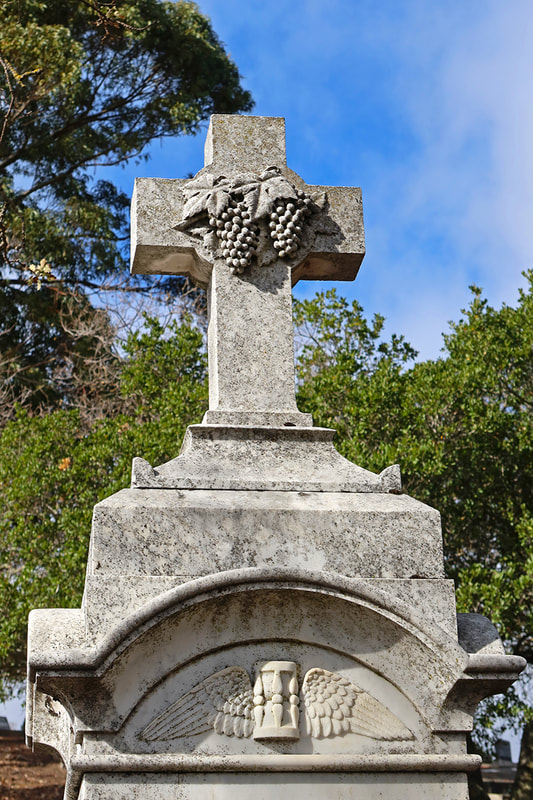 grapes on gravestone