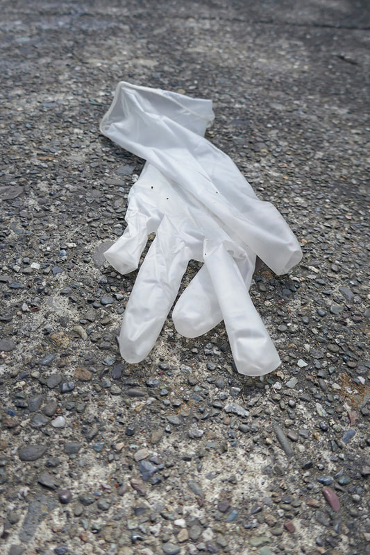 medical glove on pavement