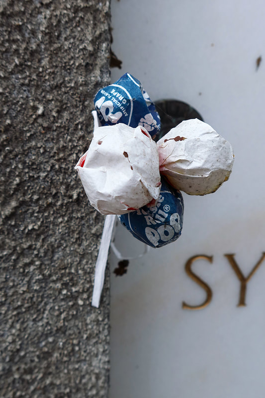 tootsie roll pops on a gravestone