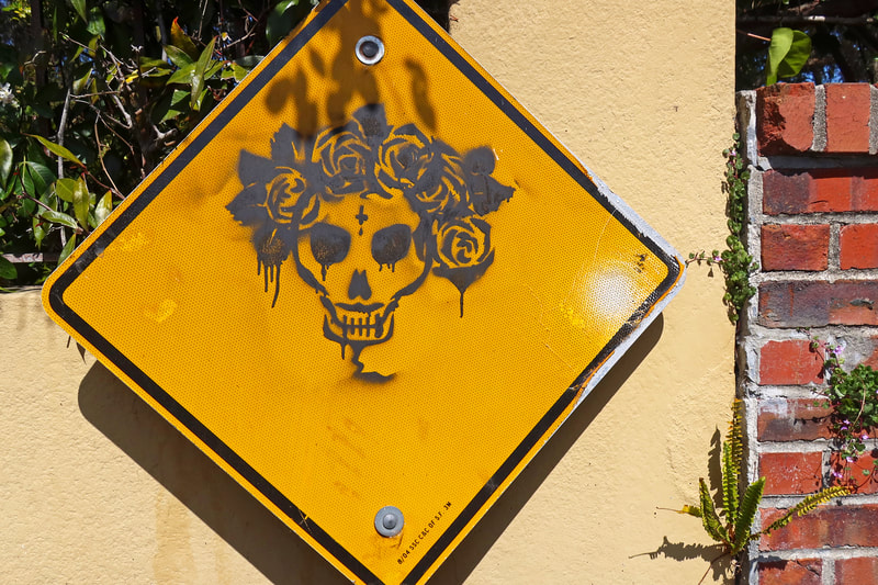 skull painted on sign
