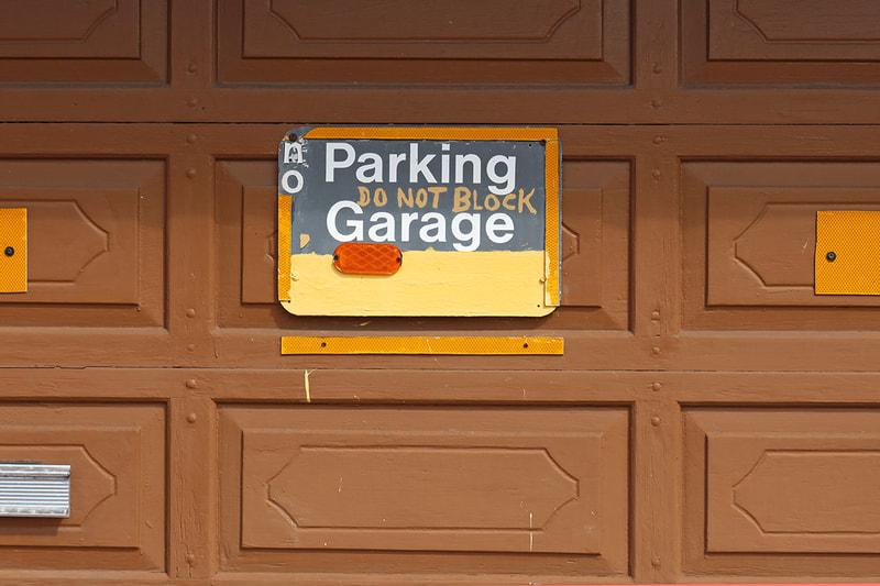 no parking sogn on garage door