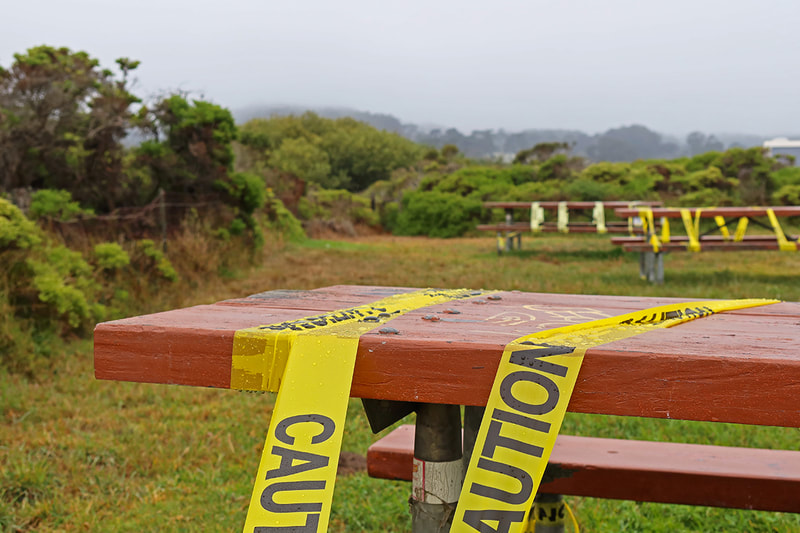 picnic tables with caution tape
