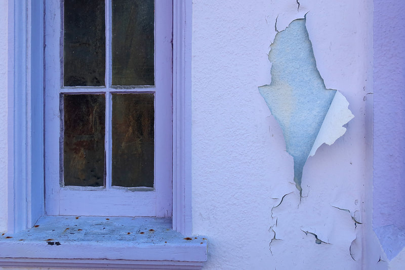 purple paint on window and wall