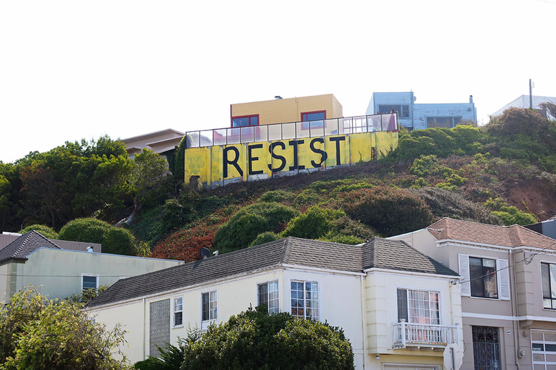 Resist painted on wall on hillside SF