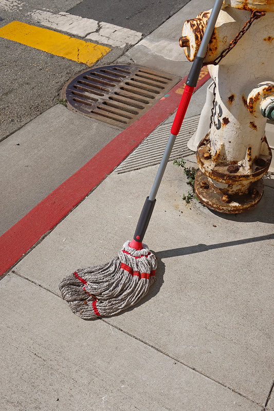 mop on sidewalk