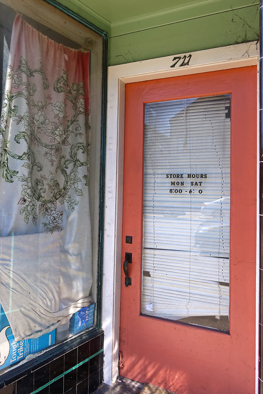 door and window of store front