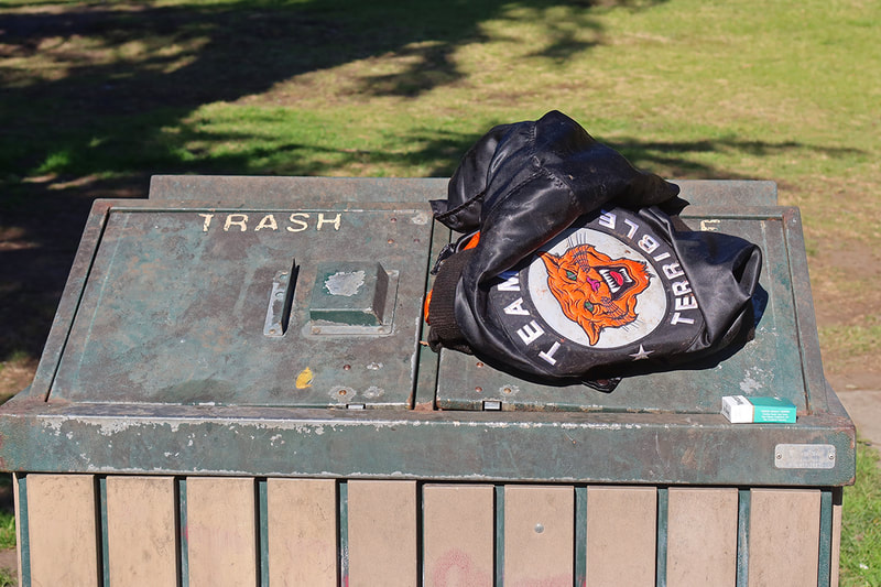 jacket on park trash cans